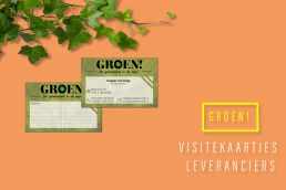Business cards on a mango colored background